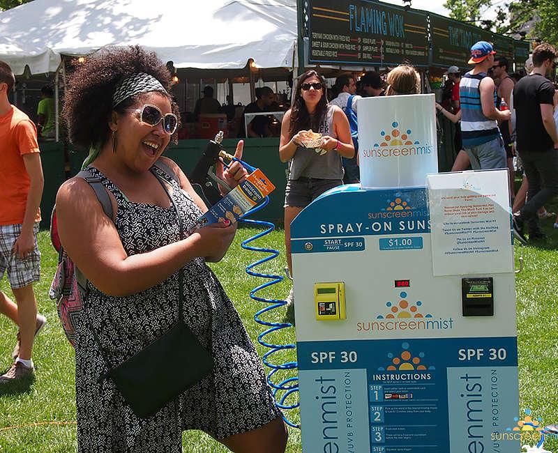 girl-spraying-sunscreen-festival