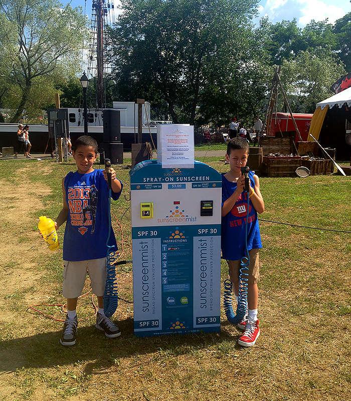 kids-at-park-spraying-sunscreen